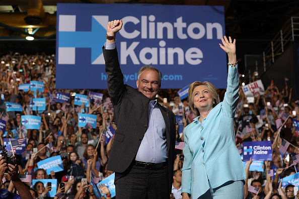 MIAMI, FL - JULY 23: Democratic presidential candidate former Secretary of State Hillary Clinton and Democratic vice presidential candidate U.S. Sen. Tim Kaine (D-VA) greet supporters during a campaign rally at Florida International University Panther Arena on July 23, 2016 in Miami, Florida. Hillary Clinton and Tim Kaine made their first public appearance together a day after the Clinton campaign announced Senator Kaine as the Democratic vice presidential candidate. (Photo by Justin Sullivan/Getty Images)