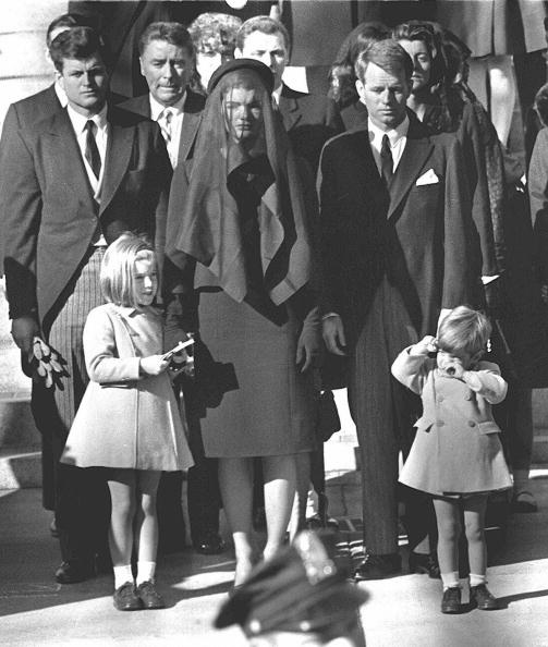 WASHINGTON, UNITED STATES:  (FILES)Jacqueline Kennedy(C) stands with her two children Caroline Kennedy(L) and John F. Kennedy, Jr.(R) and brothers-in law Ted Kennedy (L, back) and Robert Kennedy (2ndR) at the funeral of her husband US President John F. Kennedy 26 November 1963 in Washington, DC. The 40th anniversary of the death of John F. Kennedy is remembered on 22 November 2003. AFP PHOTO  (Photo credit should read STAFF/AFP/Getty Images)